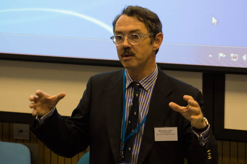 Frank Larkin gesturing as he gives a talk to NIHR in 2014.